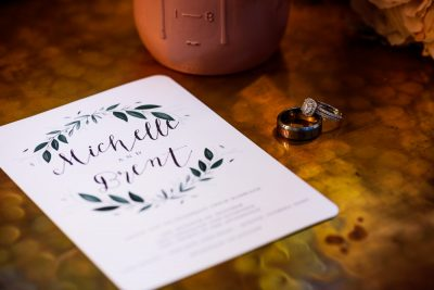 Michelle and Brent's invitation and rings, Ates Ranch Wedding Barn, Rustic Barn Wedding, Pensacola wedding photographer, Lazzat Photography