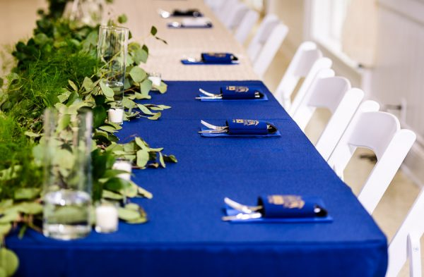 Downtown Pensacola Wedding, Kerri and Cody's table arrangements and koozie gifts, Lazzat Photography