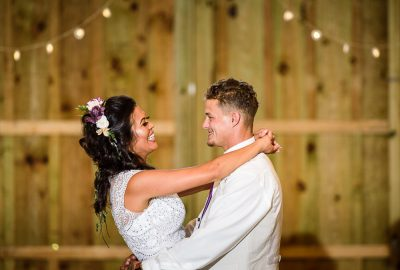 Michelle and Brent smiling at each other close up during their first dance, Ates Ranch Wedding Barn, Rustic Barn Wedding, Pensacola wedding photographer