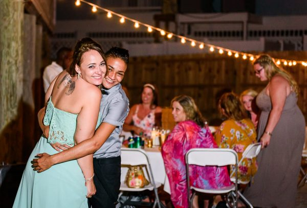 Pensacola Beach Destination Wedding, Bridesmaid and fiance hugging, Lazzat Photography