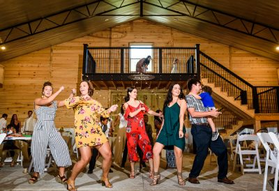 Michelle and Brent's guests dancing at Ates Ranch Wedding Barn, Rustic Barn Wedding, Pensacola wedding photographer, Lazzat Photography