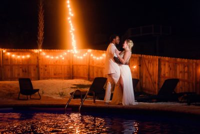 Pensacola Beach Destination Wedding, Desireé and Delaine looking at each other by the pool, Lazzat Photography