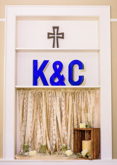 "Downtown Pensacola Wedding, ""K&C"" sign and cross decorations, Lazzat Photography"