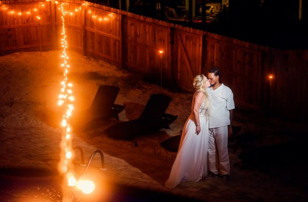 Pensacola Beach Destination Wedding, Desireé and Delaine kissing by the pool, Lazzat Photography