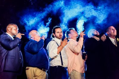 Downtown Pensacola Wedding, Cody and his friends smoking cigars, Lazzat Photography