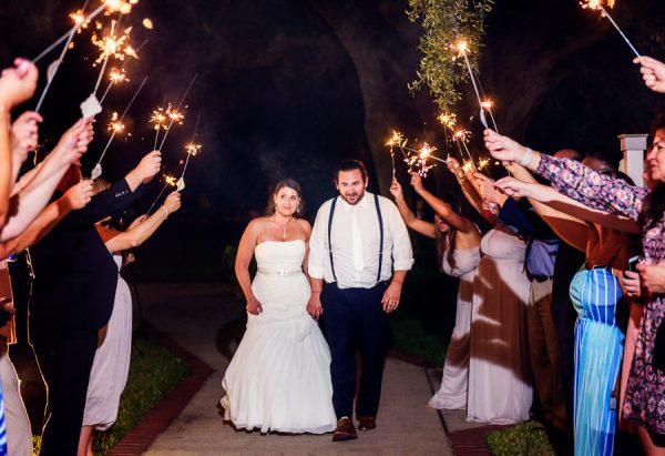 Downtown Pensacola Wedding, Kerri + Cody walking through sparklers, Lazzat Photography