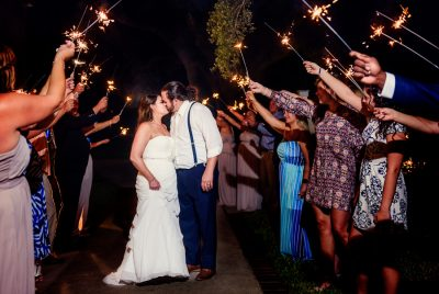 Downtown Pensacola Wedding, Kerri + Cody kissing with sparklers around them, Lazzat Photography