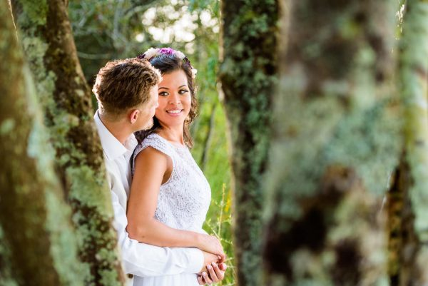 Brent and Michelle through the trees outside Ates Ranch Wedding Barn, Rustic Barn Wedding, Pensacola wedding photographer, Lazzat Photography