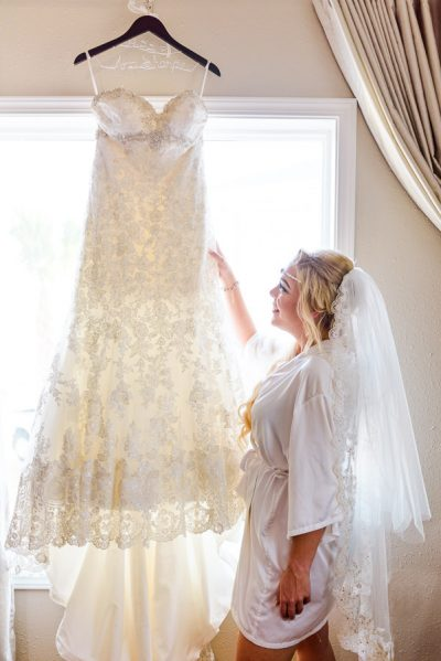 Pensacola Beach Destination Wedding, Desireé looking at her dress, Lazzat Photography