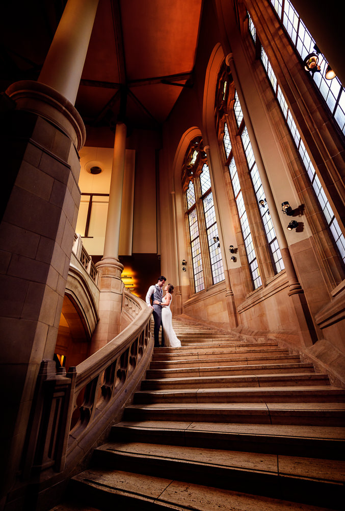 Couple looking at each other on a huge staircase in the Suzzallo library, Epic Couple's Session in Seattle, Lazzat Photography, Engagement photos, wedding photos