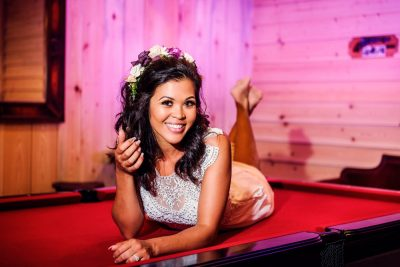 Michelle laying on the pool table at Ates Ranch Wedding Barn, Rustic Barn Wedding, Pensacola wedding photographer, Lazzat Photography