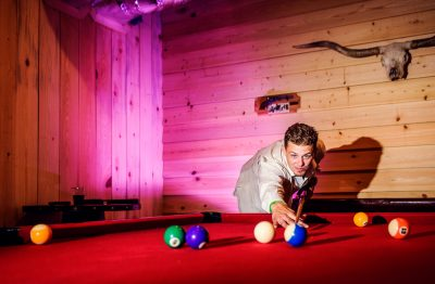 Brent playing pool at Ates Ranch Wedding Barn, Rustic Barn Wedding, Pensacola wedding photographer, Lazzat Photography