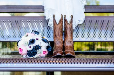 Ashley's cowboy boots from Hill with her bouquet and bottom of her wedding dress, Pensacola Waterfront Wedding, Ashley+Hill, Lazzat Photography