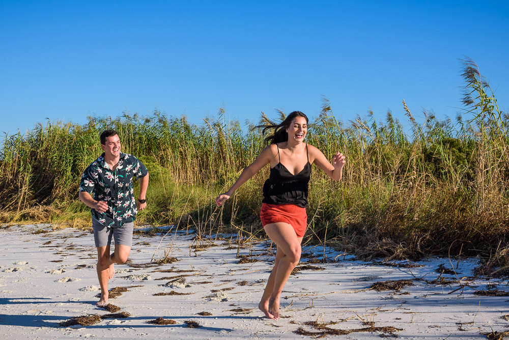 Alec chasing Timber down the beach during their Ft. Pickens Sunset Engagement Session, Timber+Alec, Ft. Pickens Sunset Engagement Session, Pensacola engagement photographer, Pensacola engagement photo session, Pensacola engagement photos, Pensacola engagement photography, Lazzat Photography