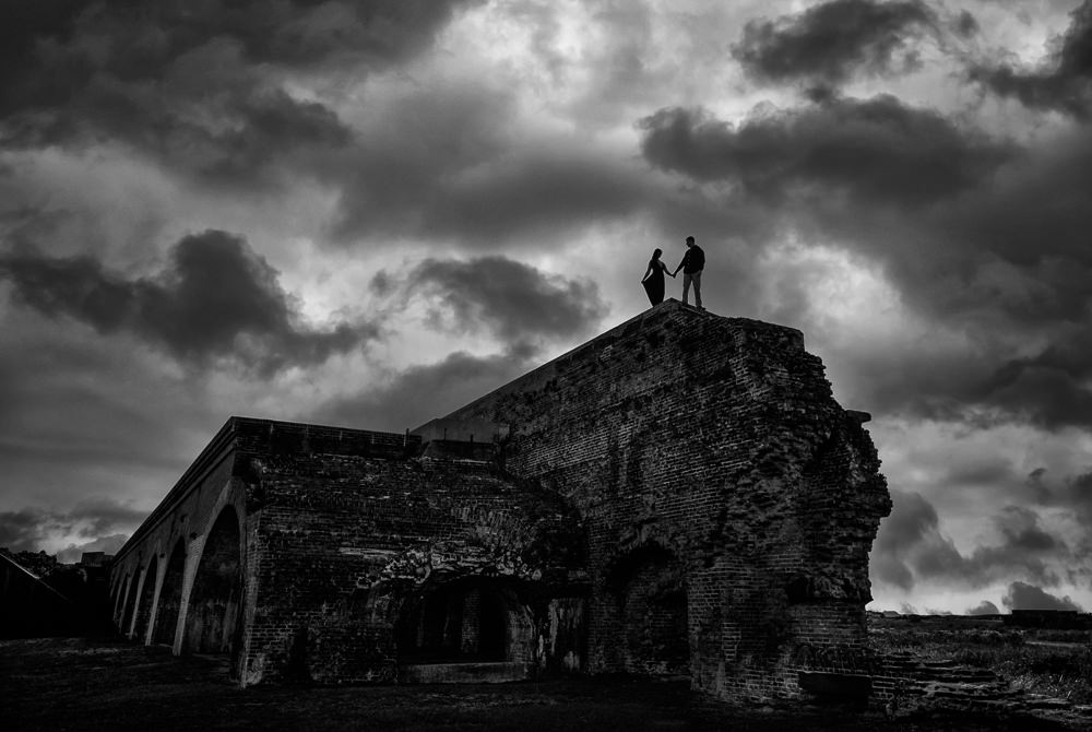 Timber+Alec on top of the wall during their Ft. Pickens Sunset Engagement Session, black and white, Timber+Alec, Ft. Pickens Sunset Engagement Session, Pensacola engagement photographer, Pensacola engagement photo session, Pensacola engagement photos, Pensacola engagement photography, Lazzat Photography