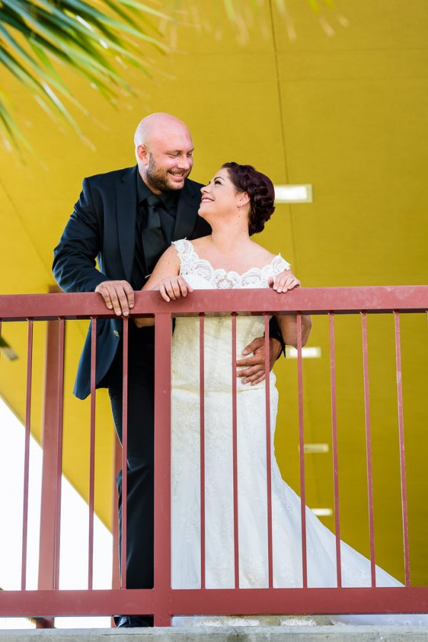 Ashley and Hill smiling at each other along the railing, Pensacola Waterfront Wedding, Ashley+Hill, Lazzat Photography