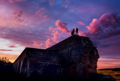 Timber+Alec on top of the wall with epic sunset during their Ft. Pickens Sunset Engagement Session, Timber+Alec, Ft. Pickens Sunset Engagement Session, Pensacola engagement photographer, Pensacola engagement photo session, Pensacola engagement photos, Pensacola engagement photography, Lazzat Photography