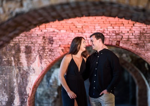 Timber+Alec laughing at each other in the arches at Ft. Pickens during their Sunset Engagement Session, Timber+Alec, Ft. Pickens Sunset Engagement Session, Pensacola engagement photographer, Pensacola engagement photo session, Pensacola engagement photos, Pensacola engagement photography, Lazzat Photography