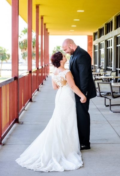 Ashley and Hill holding hands and smiling at each other, Pensacola Waterfront Wedding, Ashley+Hill, Lazzat Photography