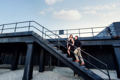 Timber and Alec walking up the black metal stairs during their Ft. Pickens Sunset Engagement Session, Timber+Alec, Ft. Pickens Sunset Engagement Session, Pensacola engagement photographer, Pensacola engagement photo session, Pensacola engagement photos, Pensacola engagement photography, Lazzat Photography