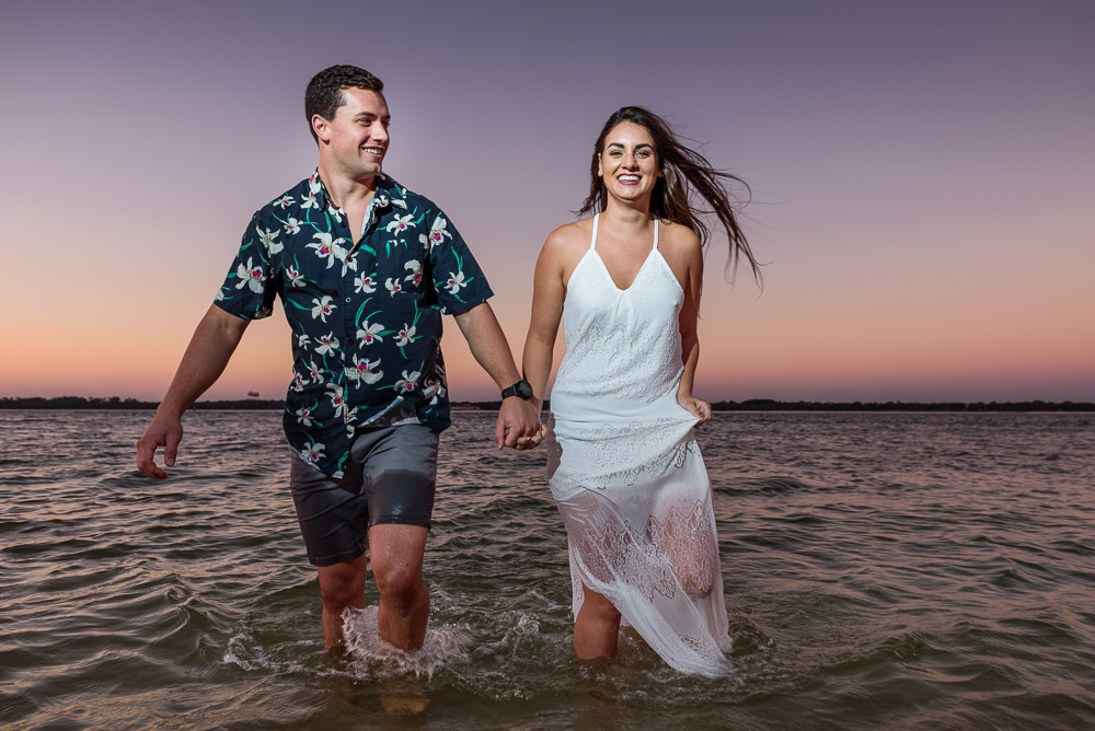 Timber+Alec walking out of the water towards the camera during their Ft. Pickens Sunset Engagement Session, Timber+Alec, Ft. Pickens Sunset Engagement Session, Pensacola engagement photographer, Pensacola engagement photo session, Pensacola engagement photos, Pensacola engagement photography, Lazzat Photography