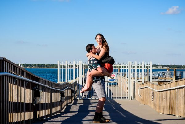 Alec picking Timber up on the pier during their Ft. Pickens Sunset Engagement Session, Timber+Alec, Ft. Pickens Sunset Engagement Session, Pensacola engagement photographer, Pensacola engagement photo session, Pensacola engagement photos, Pensacola engagement photography, Lazzat Photography