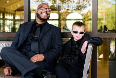 Hill's best man and son sitting on the bench smiling, Pensacola Waterfront Wedding, Ashley+Hill, Lazzat Photography