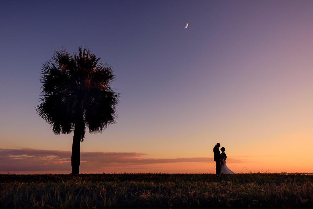 silhouette of Hill and Ashley looking at each other at sunset with the moon, Pensacola Waterfront Wedding, Ashley+Hill, Lazzat Photography
