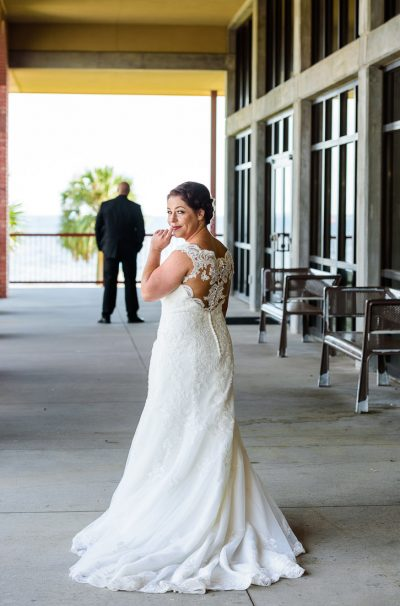 "Ashley giving the ""shh"" sign before her first look with Hill, Pensacola Waterfront Wedding, Ashley+Hill, Lazzat Photography"
