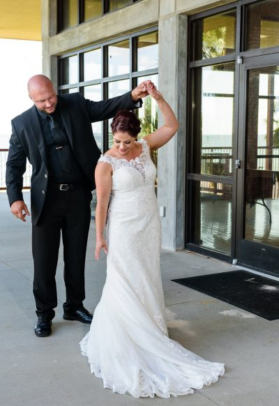 Hill spinning Ashley during their first look, Pensacola Waterfront Wedding, Ashley+Hill, Lazzat Photography