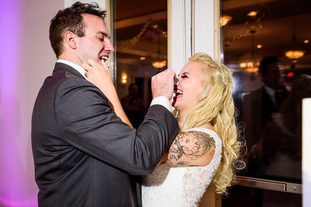 Bride and Groom feeding each other cake, Star Wars Wedding in Scenic Hills Country Club, Lazzat Photography