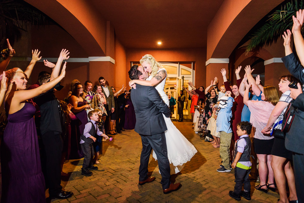 Bride and Groom kissing during grand exit, Star Wars Wedding in Scenic Hills Country Club, Lazzat Photography