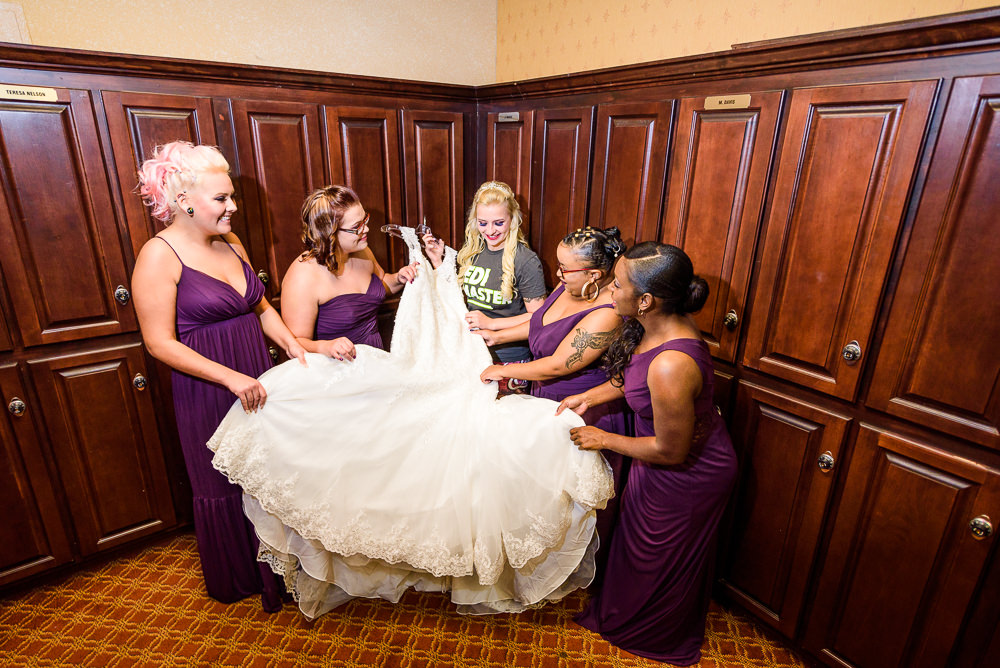 Bride and Bridesmaids holding her lace wedding dress, purple bridesmaid dresses, Star Wars Wedding in Scenic Hills Country Club, Lazzat Photography