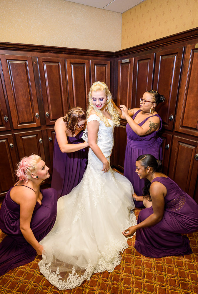 Bridesmaids helping the bride get dresses, lace wedding dress, purple bridesmaid dresses, Star Wars Wedding in Scenic Hills Country Club, Lazzat Photography