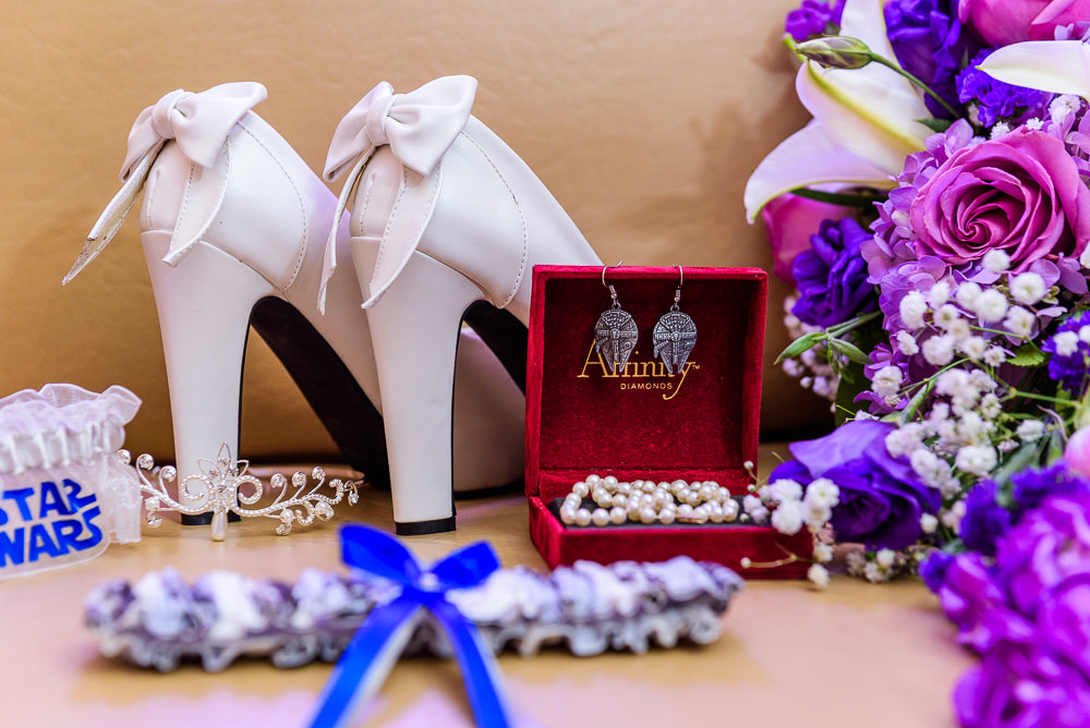 Bride's details, white wedding heels with bows, tiara, pearls, star wars garter, millennium falcon earrings, Star Wars Wedding in Scenic Hills Country Club, Lazzat Photography