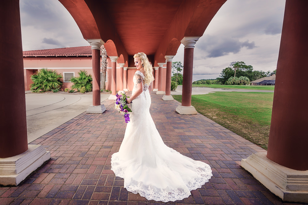 Bridal portrait of her back, lace wedding dress, purple and pink flowers, Star Wars Wedding in Scenic Hills Country Club, Lazzat Photography