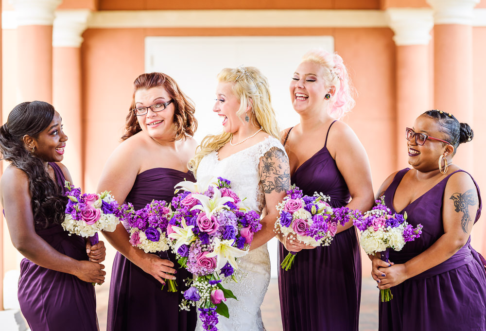 Bride and Bridesmaids laughing, purple and pink flowers, purple bridesmaid dresses, Star Wars Wedding in Scenic Hills Country Club, Lazzat Photography