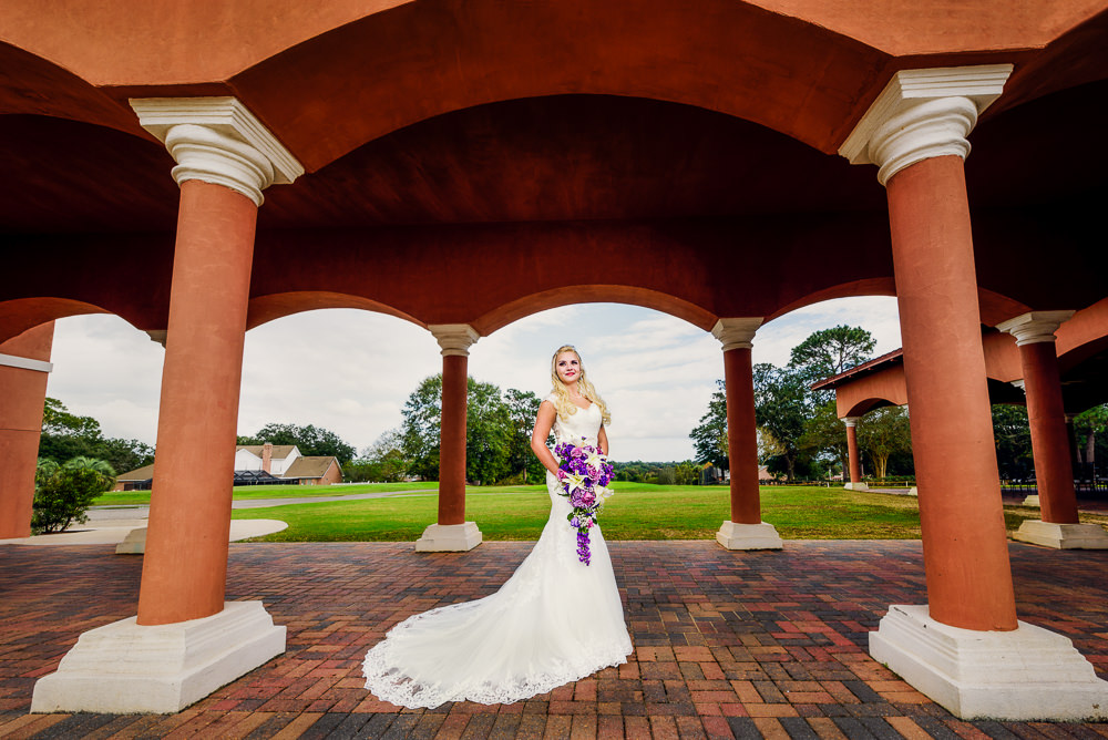 Bridal portrait outside, lace wedding dress, purple and pink flowers, Star Wars Wedding in Scenic Hills Country Club, Lazzat Photography