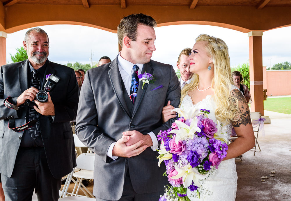 Bride taking the Groom's arm during the wedding ceremony, Star Wars Wedding in Scenic Hills Country Club, Lazzat Photography