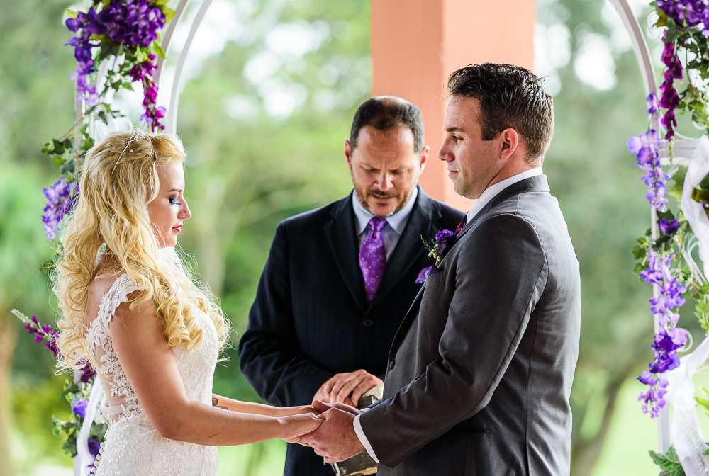 Bride and Groom holding hards during the wedding ceremony, Star Wars Wedding in Scenic Hills Country Club, Lazzat Photography