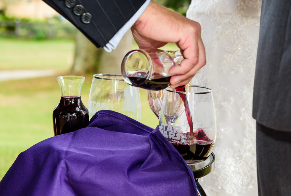 Officiant pouring wine for communion during the wedding ceremony, Star Wars Wedding in Scenic Hills Country Club, Lazzat Photography