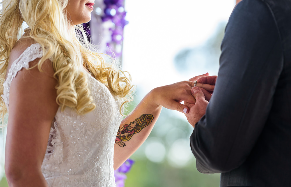 Groom giving his Bride her ring, Star Wars Wedding in Scenic Hills Country Club, Lazzat Photography