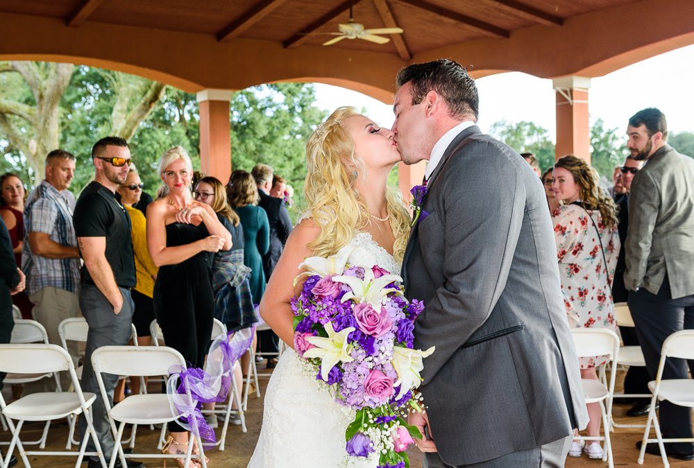 Bride and Groom kissing at the end of the aisle, Star Wars Wedding in Scenic Hills Country Club, Lazzat Photography