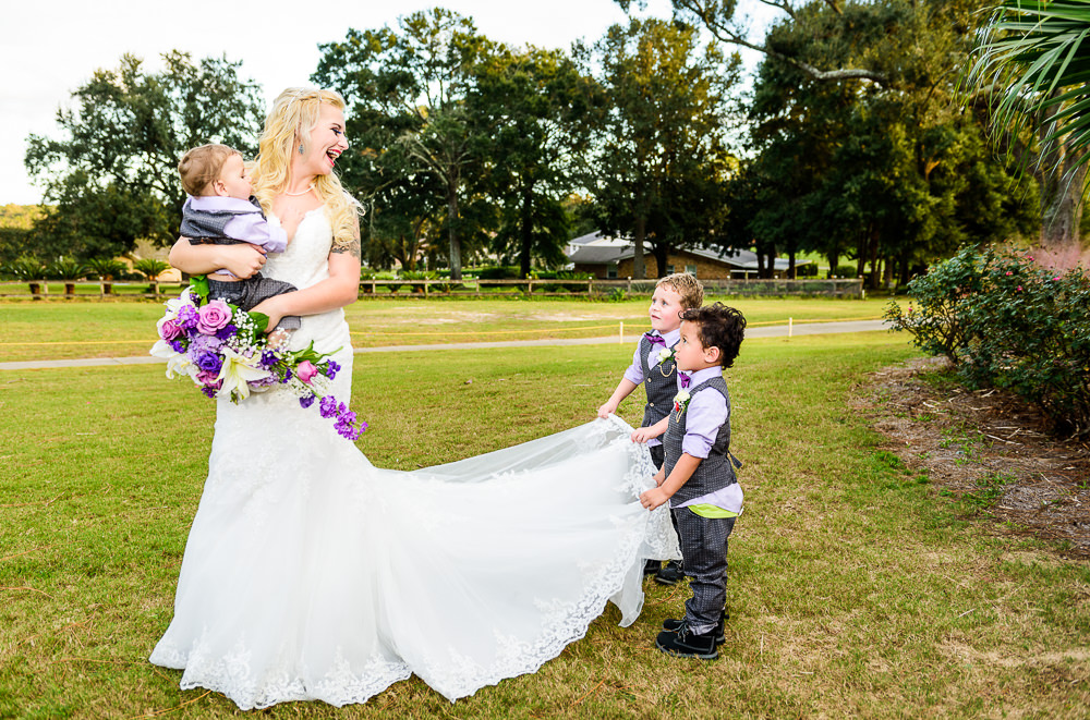 Bride's son's helping hold up her dress, Star Wars Wedding in Scenic Hills Country Club, Lazzat Photography