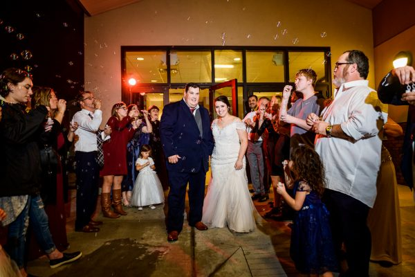 Ocean Springs Winter Wedding | Lena+Harold | Grand exit with bubbles | Lazzat Photography | Central Florida Photographer
