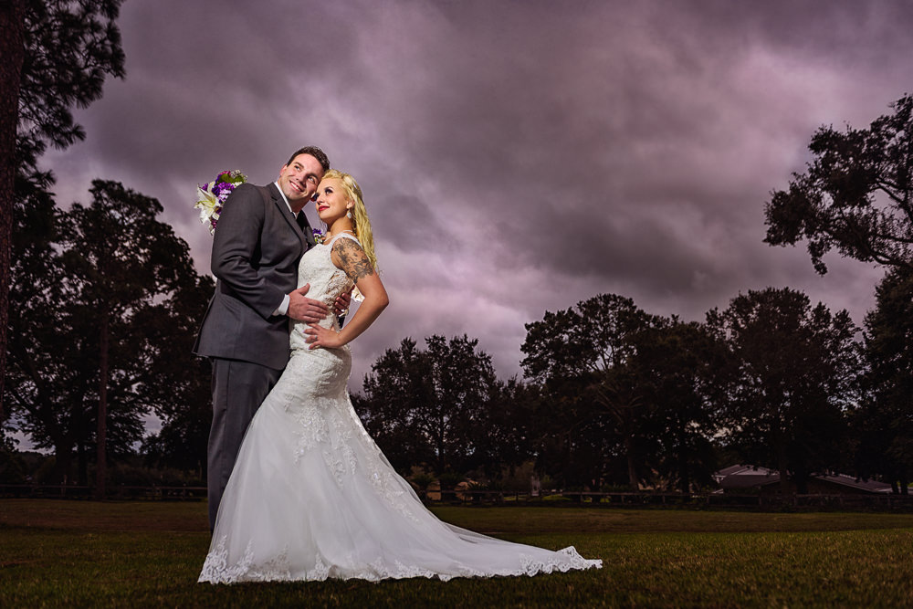 Bride and Groom looking into the distance at night, Star Wars Wedding in Scenic Hills Country Club, Lazzat Photography