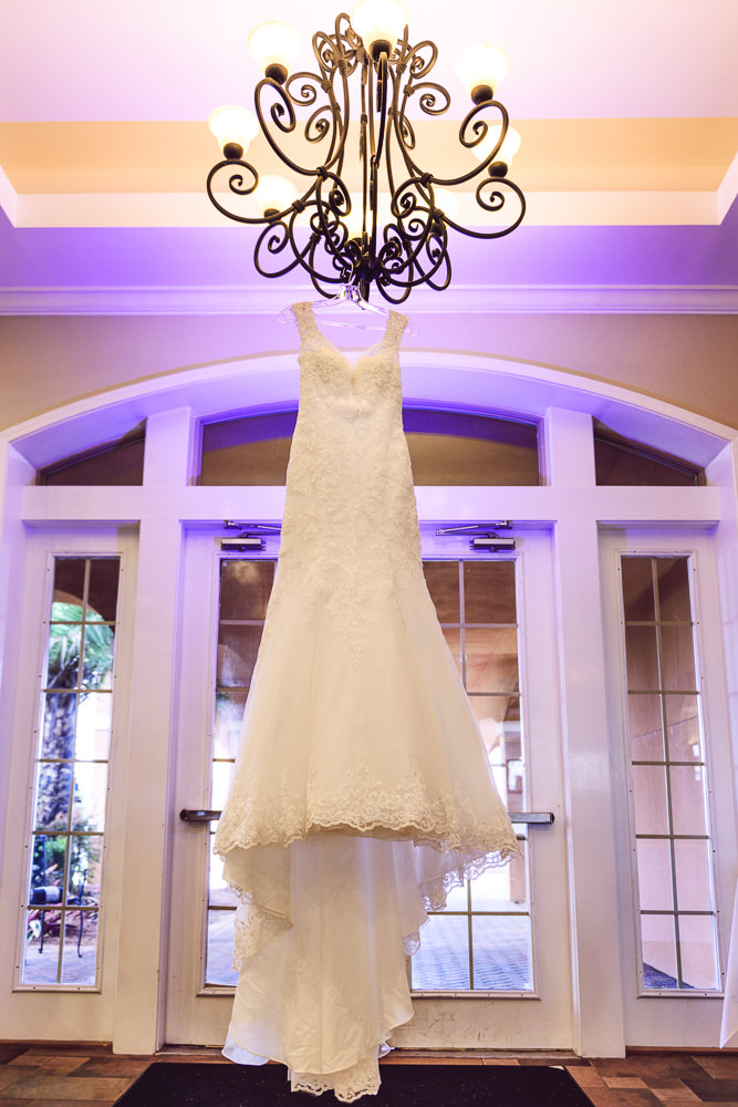 Bride's dress hanging on chandelier, Star Wars Wedding in Scenic Hills Country Club, Lazzat Photography