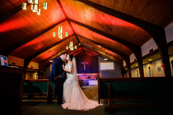 best wedding photographer Pensacola Orlando | creative imagery by Lazzat Photography | couple in church with red ceiling | epic wedding photo