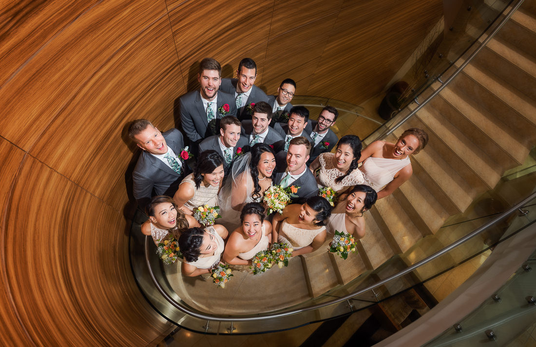 best wedding photographer Pensacola Orlando | creative imagery by Lazzat Photography | wedding bridal party on staircase at Pan Pacific Hotel in Seattle | unique pose