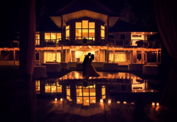 best wedding photographer Pensacola Orlando | creative imagery by Lazzat Photography | dramatic image princess inspired silhouette of bride and groom dancing with reflection at the bottom of their castle like home